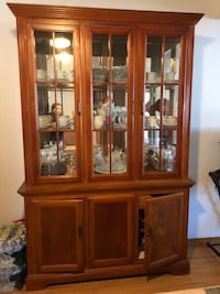 Brown wooden framed glass display cabinet 202 mi