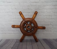brown wooden ship wheel wall decor Toronto, M6S 3N4