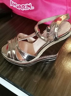 unpaired gray patent leather open-toe ankle strap wedge