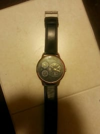 round black chronograph watch with black leather strap Moncton, E1A 8K4