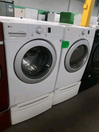 LG FRONT LOAD WASHER AND DRYER SET WITH PEDESTAL WORKING PERFECTLY Baltimore, 21201