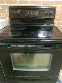 black smooth-top range oven Burnaby, V5A 1T4