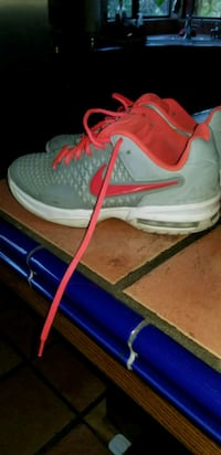 pair of gray-and-orange Nike running shoes Bakersfield, 93308
