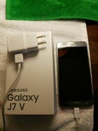silver Samsung Galaxy J7 V smartphone with box and
