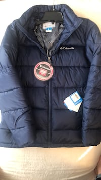 Navy medium Columbia winter jacket. Never worn. With thermal coil. Tags still on  Baltimore, 21206