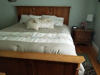 brown wooden bed frame with white bed sheet MEDINA