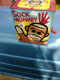 Sock monkey wind is up and it pops up Macon