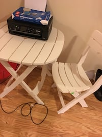 White plastic folding chair and table