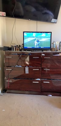 black flat screen TV with brown wooden TV stand Santa Maria, 93454