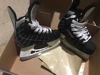 pair of black-and-white ice skates Edmonton, T5W 4R4