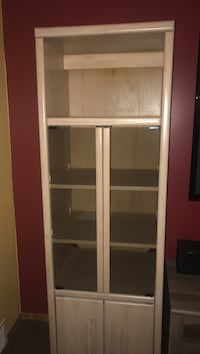 Blonde wooden framed glass cabinet