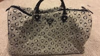 Monogrammed gray and black guess luggage bag