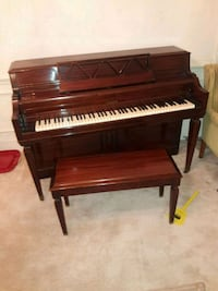 brown wooden upright piano with chair Chamblee, 30341