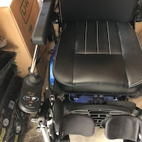 black and blue motorized wheelchair Bristow, 20136