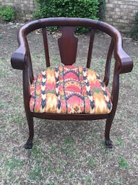 brown wooden framed pink and green floral padded armchair