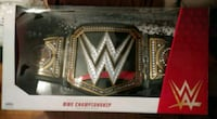 Wwe championship and T.R.U. roman reigns figure Lake Grove, 11755