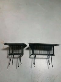 two black metal framed brown wooden tables 535 km
