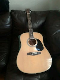 Guitar, Acustic 6 sting BC, hot bag and tuner nice new condition.