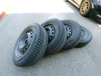 two gray auto wheel with tires Toronto, M6A 2T9