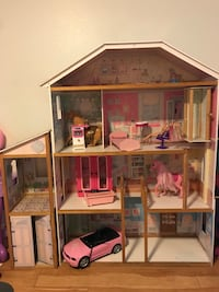 brown and pink wooden dollhouse