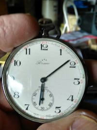 round silver framed analog watch and silver Pocket