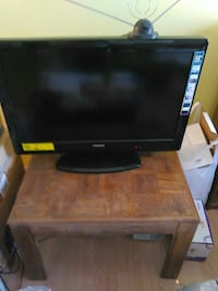 black flat screen TV with remote Los Angeles, 91402