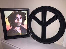 black wooden photo frame and piece sign table decor