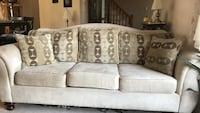 White fabric 3-seat sofa with pillows