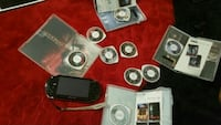 black Sony PSP with game cases Los Angeles, 90057