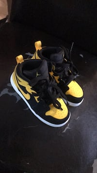 Pair of black-and-yellow nike basketball shoes Jacksonville, 28546