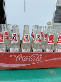 19 bottles and old coke case Coker, 35452