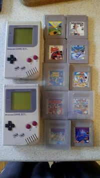 white Nintendo Game Boy with game cartridges