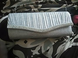 Silver across the chest purse