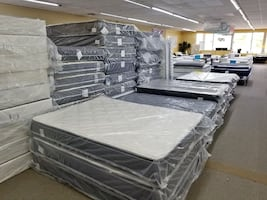 Huge savings w/ over half off new mattresses in the plastic!!!