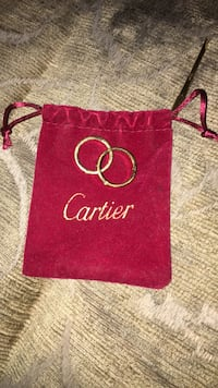 gold cartier wedding band with red drawstring pouch Bladensburg, 20710