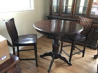 Brown wooden pedestal table with 2 chairs. Almost new - 2 months old Laurel