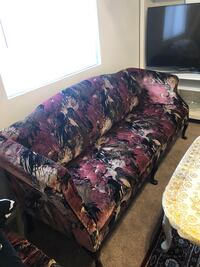 Brown and black floral sofa chair