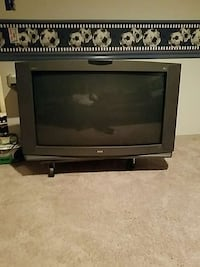 black CRT TV with brown wooden TV stand Waldorf, 20603