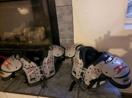 two pairs of white and black inline skates