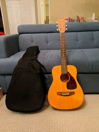 brown and black acoustic guitar Ottawa, K2S 0J8