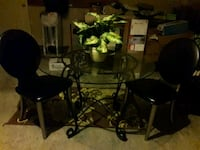 3 piece set includes heavy glass top table and 2 g Greensboro, 27405