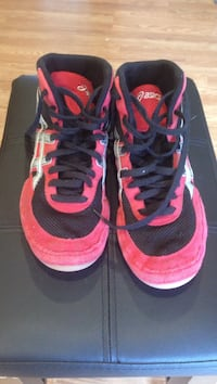 pair of red-and-black Asics high-top sneakers