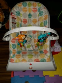 baby's white and green bouncer Fort Belvoir