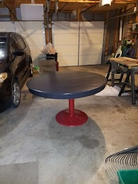 round black and red metal pedestal table.  Glen Rock, 17327