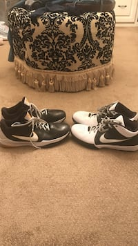 Two pairs of black-and-white nike kobe basketball shoes