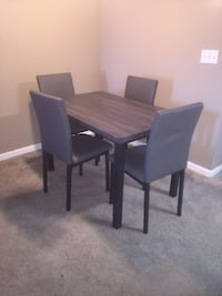 rectangular brown wooden table with four chairs dining set Houston, 77060