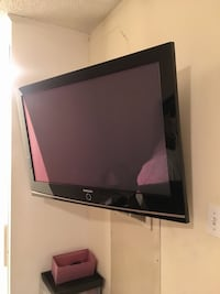 Black flat screen tv with remote East Palo Alto, 94303