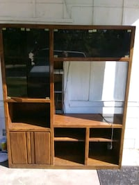 brown wooden TV hutch with flat screen television Bossier City, 71112