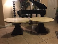 2 elegant tables made of mark David designer 20 inches tall 34 inches around of the table   2067 mi