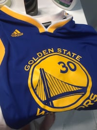 blue and yellow Golden State Warriors Stephen Curry jersey Peterborough